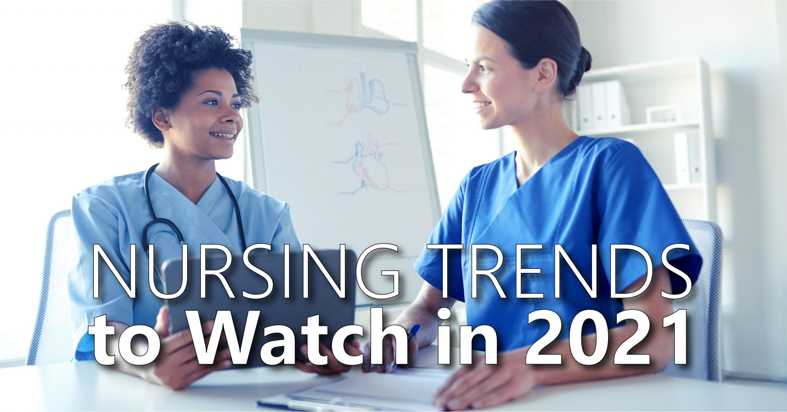 """Two nurses are smiling, facing each other in discussion. The female nurse on the left is holding a tablet device and wearing a stethoscope. The name of the article, """"Nursing Trends to Watch in 2021"""" is centered across the bottom of the image"""