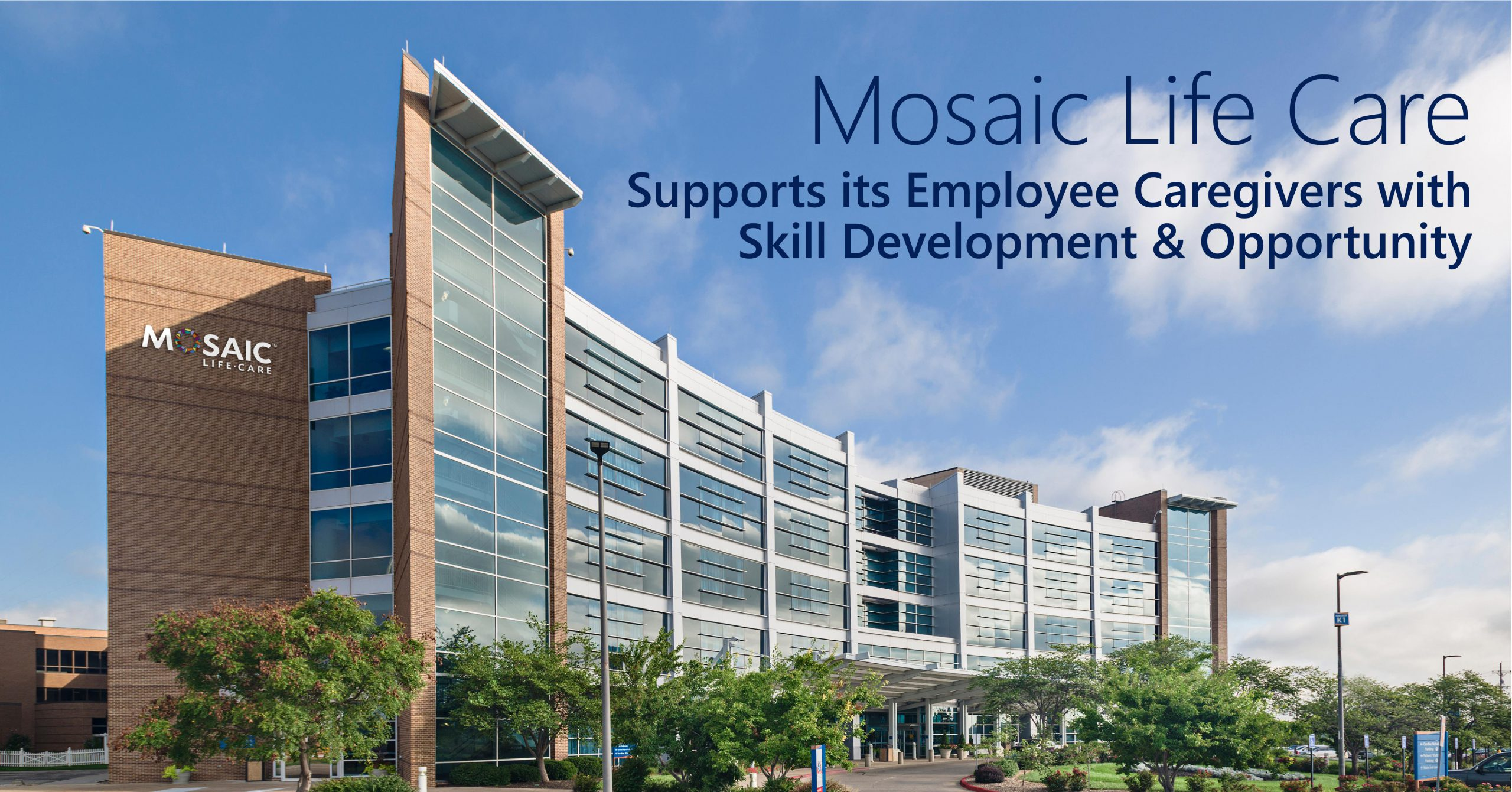 """The title of the article (Mosaic Life Care Supports its Employee Caregivers with Skill Development and Opportunity"""" is superimposed over a photo of the Mosaic Life Care hospital. The blue sky is seen overhead with a few wispy clouds. The hospital has many windows and the building has a curved shape."""